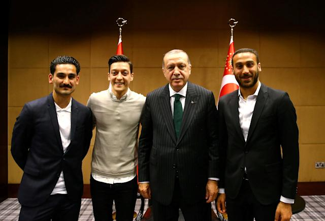 FILE PHOTO: Turkish President Tayyip Erdogan meets with Premier League soccer players Ilkay Gundogan of Manchester City, Mesut Ozil of Arsenal and Cenk Tosun of Everton in London, Britain May 13, 2018. Picture taken May 13, 2018. Kayhan Ozer/Presidential Palace/Handout via REUTERS/File Photo ATTENTION EDITORS - THIS PICTURE WAS PROVIDED BY A THIRD PARTY. NO RESALES. NO ARCHIVE.