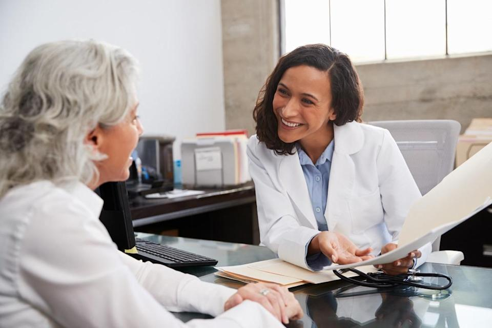 female doctor in consultation with senior patient