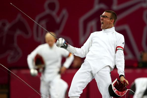 Adam Marosi of Hungary celebrates winning a bout in the fencing during the Men's Modern Pentathlon on Day 15 of the London 2012 Olympic Games on August 11, 2012 in London, England. (Photo by Quinn Rooney/Getty Images)