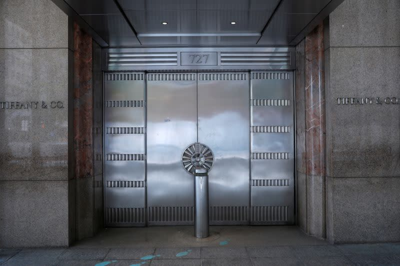 FILE PHOTO: Closed luxury retail stores on 5th Avenue in Manhattan during the outbreak of the coronavirus disease (COVID-19) in New York