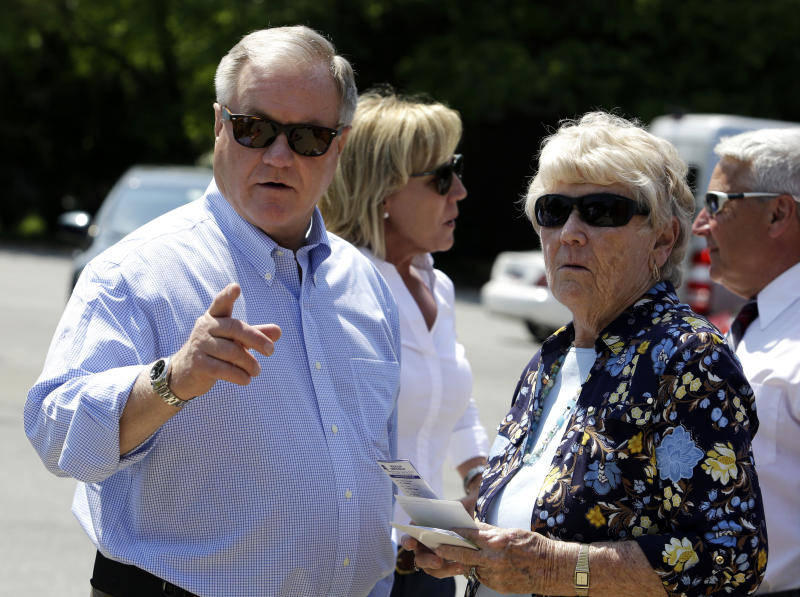 Republican candidate for Pennsylvania governor Scott Wagner, left, speaks to Springfield Township Treasurer Margaret Young as he arrives at a polling station Tuesday, May 15, 2018, in Springfield, Pa. Republican voters are deciding between three candidates to challenge Democratic Gov. Tom Wolf, who is uncontested in his primary to seek a second term in November. (AP Photo/Jacqueline Larma)