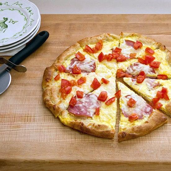 """<p>What's one surefire way to lure your little ones into the kitchen to help with the mealtime prep? The promise of <a href=""""https://www.popsugar.com/Breakfast-Pizza-24273618"""" class=""""link rapid-noclick-resp"""" rel=""""nofollow noopener"""" target=""""_blank"""" data-ylk=""""slk:breakfast pizza"""">breakfast pizza</a>. In less than 20 minutes, you can transform the delivery favorite into a protein-rich breakfast treat.</p>"""