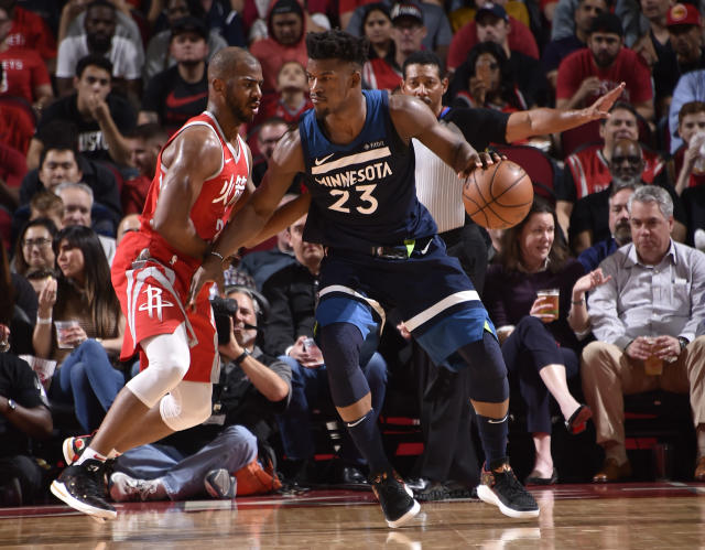 Jimmy Butler works against Chris Paul on Friday night. (Getty Images)