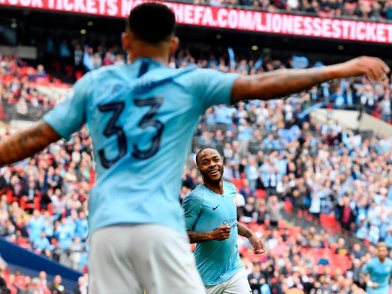 Raheem Sterling goes to celebrate with Gabriel Jesus (EPA)