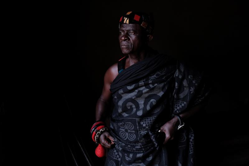 Nana Assenso, chief of Adidwan, a village in Ghana's interior, looks on before visiting the grave of his uncle Kwame Badu. (Photo: Francis Kokoroko/Reuters)