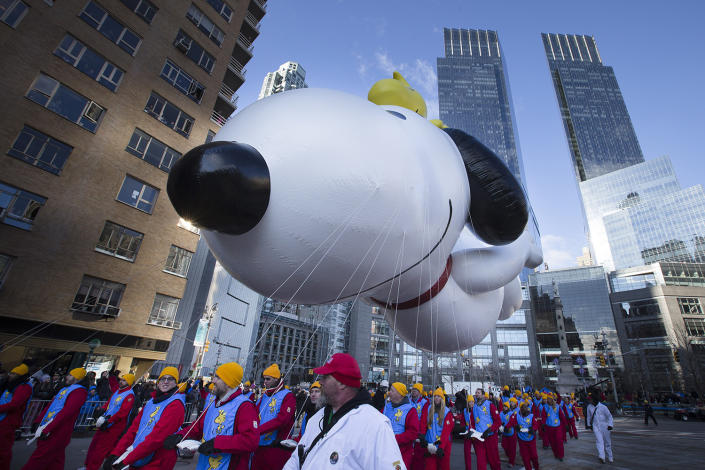 A giant Snoopy balloon is marched through Columbus Circle during the 87th Annual Macy's Thanksgiving Day Parade, Nov. 28, 2013, in New York. (Photo: John Minchillo/AP)