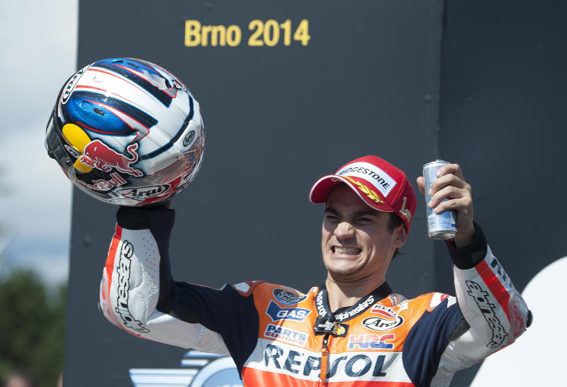 Repsol Honda Team's Spanish rider Dani Pedrosa celebrates on the podium after winning the Czech Republic Moto GP on August 17, 2014 in Brno (AFP Photo/Michal Cizek)