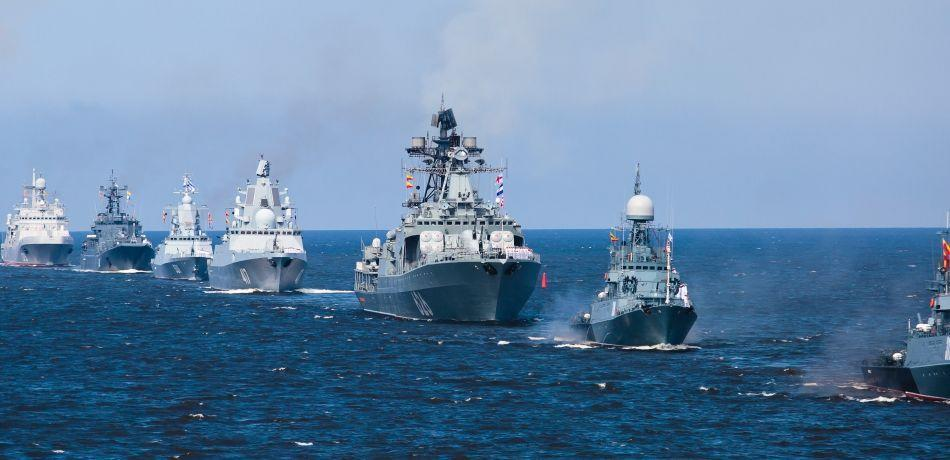 Russian Navy ships deployed at sea, in formation.