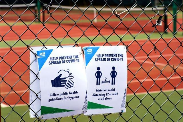 Covid signage to help prevent the spread of the virus at Wycombe House Tennis Club in Isleworth, London (John Walton/PA)