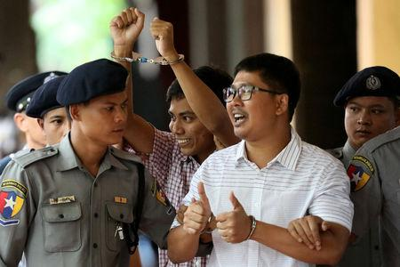 FILE PHOTO: Detained Reuters journalist Wa Lone and Kyaw Soe Oo arrive at Insein court in Yangon, Myanmar August 27, 2018. REUTERS/Ann Wang