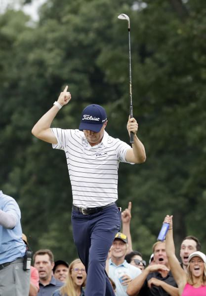 Justin Thomas celebrates after making a birdie on the 14th hole during the third round of the BMW Championship golf tournament at Medinah Country Club, Saturday, Aug. 17, 2019, in Medinah, Ill. (AP Photo/Nam Y. Huh)