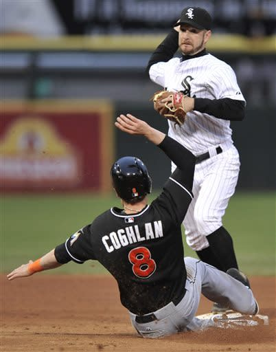 Chicago White Sox second baseman Jeff Keppinger, top, throws to first base after forcing out Miami Marlins' Chris Coghlan (8) at second base during the fifth inning of a baseball game in Chicago, Saturday, May 25, 2013. (AP Photo/Paul Beaty)