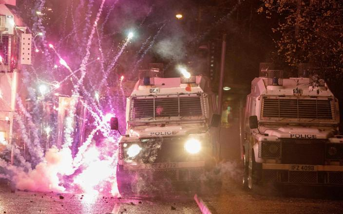Police vehicles were pelted with fireworks on Thursday night - GETTY IMAGES