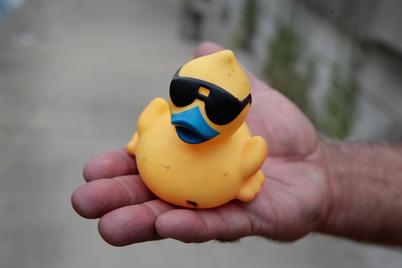 <p>A volunteer holds a rubber duck recovered from the Chicago River following the Windy City Rubber Ducky Derby on August 3, 2017 in Chicago, Illinois. (Photo: Scott Olson/Getty Images) </p>