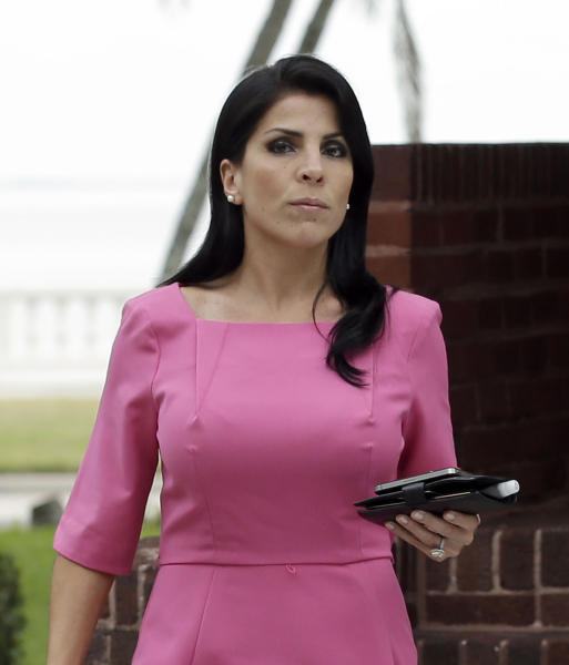 FILE - In this Nov. 13, 2012 file photo, Jill Kelley leaves her home Tuesday, Nov 13, 2012 in Tampa, Fla. South Korea will revoke an honorary title given to the American socialite tied to the scandal involving former CIA director David Petraeus, officials said Tuesday, Nov. 27, 2012. (AP Photo/Chris O'Meara)