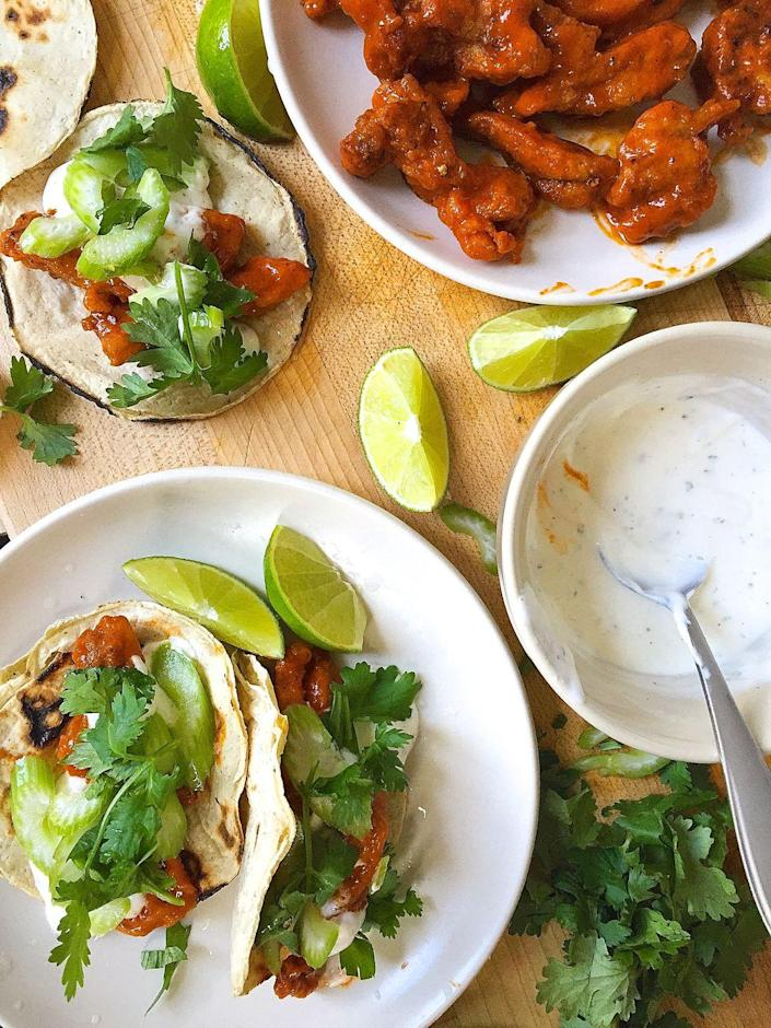 """<p>This is maybe the first time you've ever been OK with a taco without guac.</p><p>Get the recipe from <a href=""""https://www.delish.com/cooking/recipes/a43622/buffalo-chicken-tacos-with-ranch-crema-recipe/"""" rel=""""nofollow noopener"""" target=""""_blank"""" data-ylk=""""slk:Delish"""" class=""""link rapid-noclick-resp"""">Delish</a>.</p>"""
