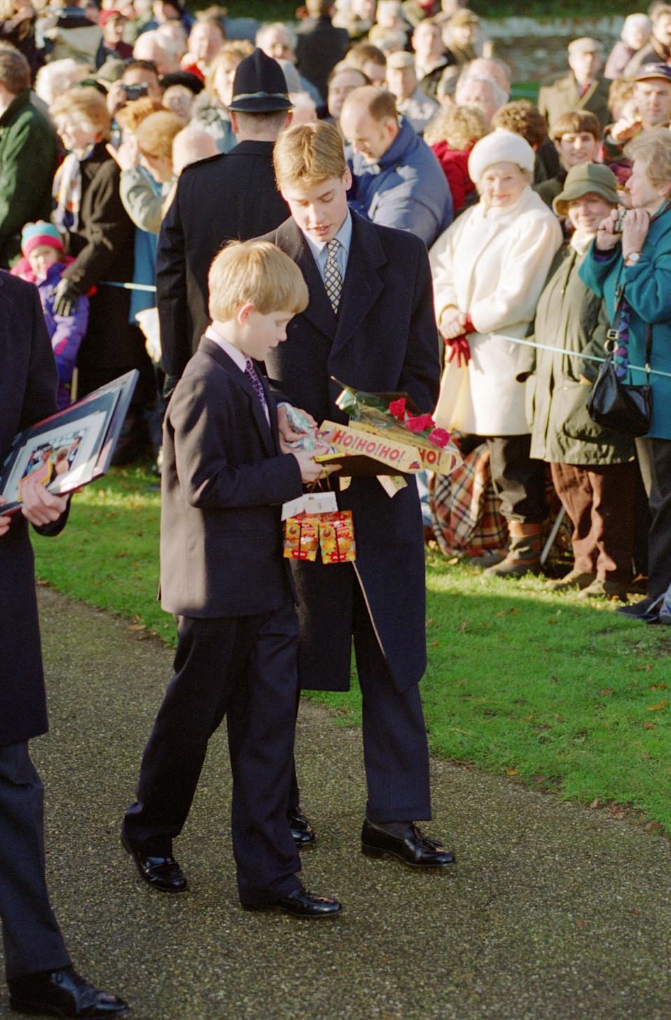 A young Prince Harry and Prince William inspect presents they received from the crowd in 1996. Photo: Getty Images