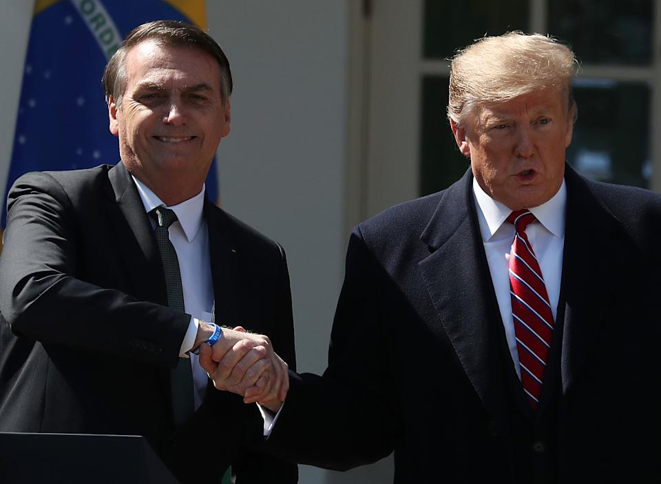 WASHINGTON, DC - MARCH 19: U.S. President Donald Trump and Brazilian President Jair Bolsonaroparticipate shake hands after a joint news conference at the Rose Garden of the White House March 19, 2019 in Washington, DC. President Trump is hosting President Bolsonaro for a visit and bilateral talks at the White House today. (Photo by Mark Wilson/Getty Images)