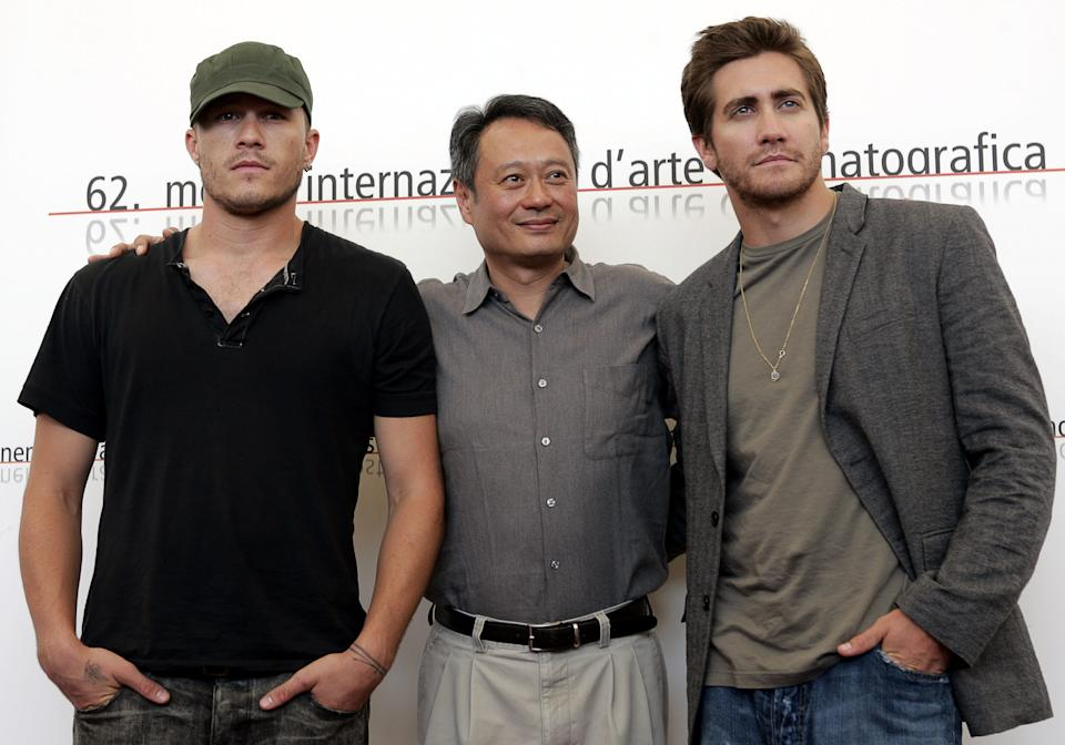 """Chinese movie director Ang Lee, center,is flanked by Australian actor Heath Ledger, left, and US actor Jake Gyllenhaal during a photocall after a press conference to present their latest movie """"Brokeback Mountain"""" at the 62nd edition of the Venice Film Festival in Venice's Lido, northern Italy, Friday, Sept. 2, 2005. (AP Photo/Domenico Stinellis)"""
