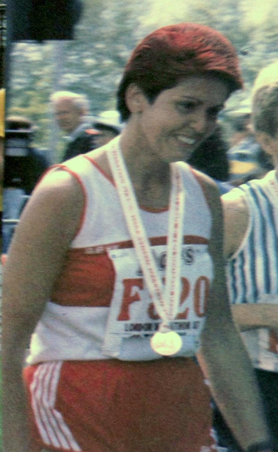 Jasmine Flatters at the end of 1987 London Marathon when she sprayed her hair red to get the crowd's attention (Jasmine Flatters/PA) (PA Media)