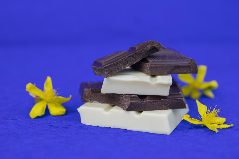 pieces of milk chocolate and dark chocolate  decorated with yellow flowers