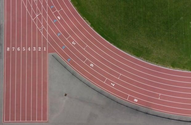 The empty starting positions at a track facility are seen from above May 6, 2021 in Ottawa. Provincial COVID-19 measures restrict access to facilities like this.