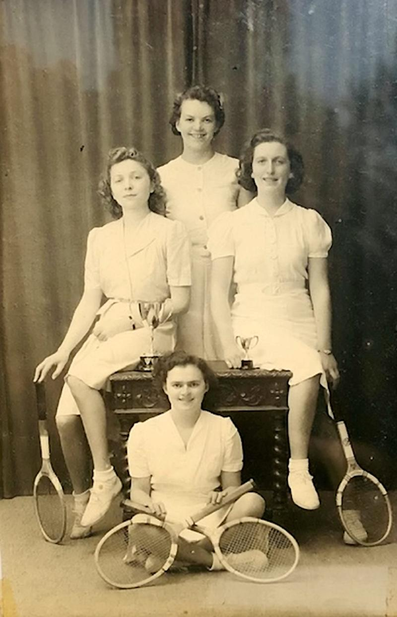 Millie (pictured on floor) was born on St George's Day in 1920 (SWNS)