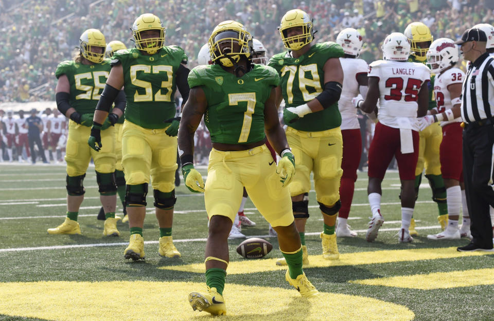 Oregon running back CJ Verdell (7) celebrates his touchdown in the first quarter of an NCAA college football game against Fresno State, Saturday, Sept. 4, 2021, in Eugene, Ore. (AP Photo/Andy Nelson)