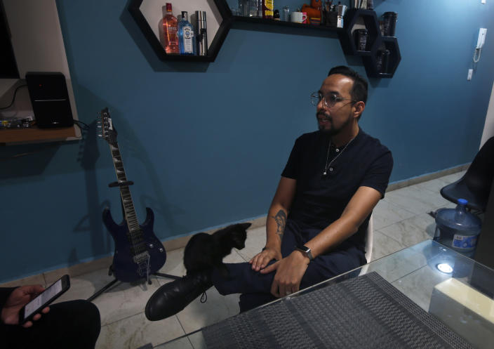 Erik Bravo, 34, a survivor of Monday's subway collapse, speaks during an interview in Mexico City, Thursday, May 6, 2021. Three days after one of the worst accidents of the Mexico City subway system, Bravo says he still cannot process everything that has happened, but repeats that he was one of the lucky ones in a tragedy that left at least 25 dead and more than 70 injured. (AP Photo/Marco Ugarte)
