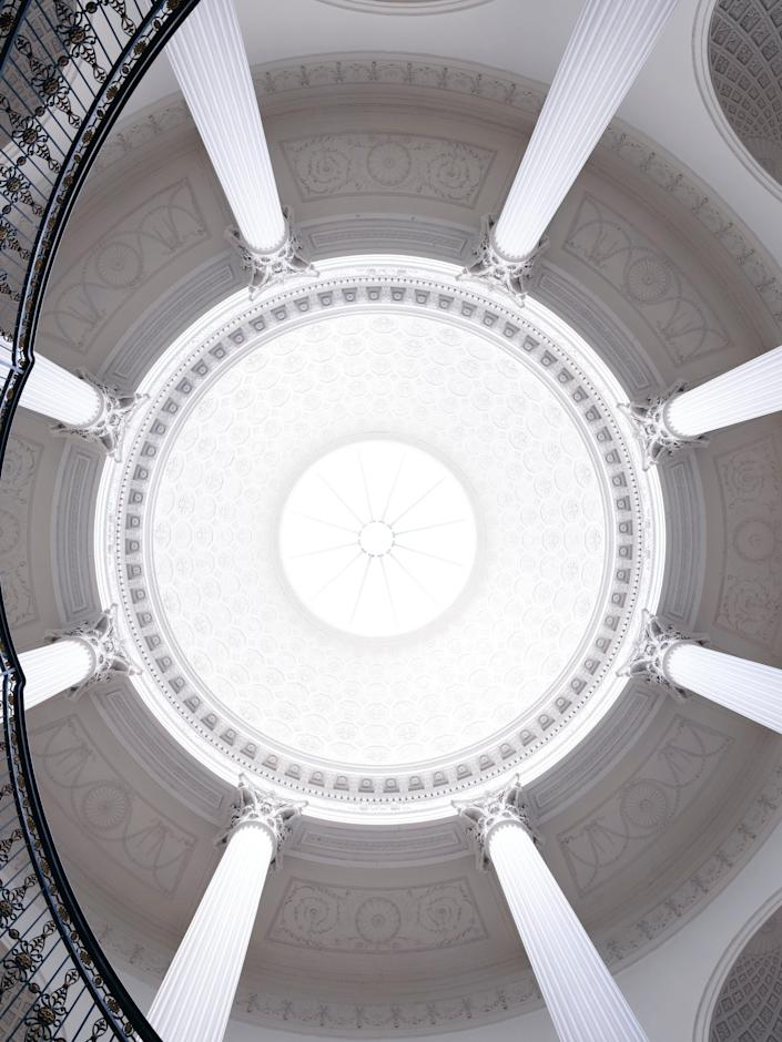 A look up at the ceiling of the same interior space.