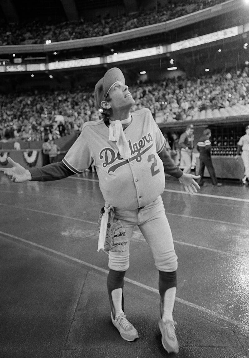 Dodgers outfielder Jay Johnstone wear a padded version of manager Tommy Lasorda's uniform.