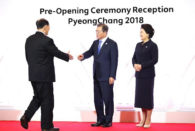 South Korean President Moon Jae-in (centre) and his wife Kim Jung-Suk greet North Korean dignitary Kim Yong Nam, during the Olympic opening ceremony in Pyeongchang, on February 9, 2018 (AFP Photo/Kim Hong-Ji)