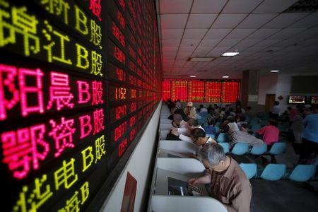 Investors look at computer screens showing stock information at a brokerage house in Shanghai, May 26, 2015. REUTERS/Aly Song/Files