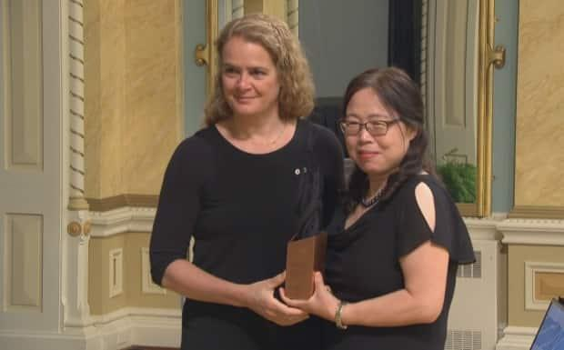 Qiu, right, was given a Governor General's award in 2018 for helping to develop ZMapp, a treatment for the deadly Ebola virus.