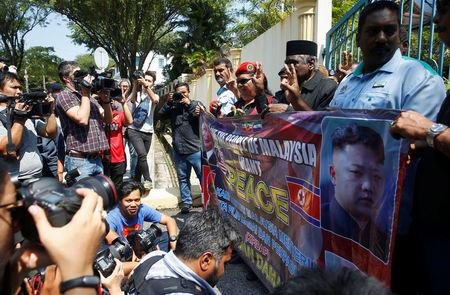 A group of people call for better relations between North Korea and Malaysia outside the North Korean embassy in Kuala Lumpur