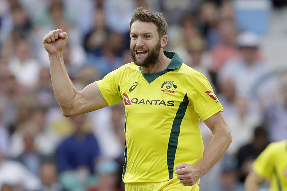 FILE -- In this June 13, 2018, file photo, Australia's Andrew Tye celebrates taking the wicket of England captain Eoin Morgan during the one-day cricket match between England and Australia at the Oval cricket ground in London. Fast bowler Tye has been brought into the Australian squad for the one-day international and Twenty20 series against India in place of Kane Richardson. Cricket Australia said Wednesday, Nov. 18, 2020 that Richardson has withdrawn from the squad to be with his wife and their newborn son. (AP Photo/Matt Dunham, File)