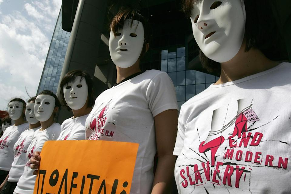 Amnesty International activists wearing T-shirts reading 'end modern slavery' protest against human trafficking in Athens, Greece: LOUISA GOULIAMAKI/AFP via Getty Images
