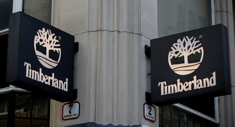 FILE PHOTO: Company logos are pictured outside a Timberland shop in Vienna