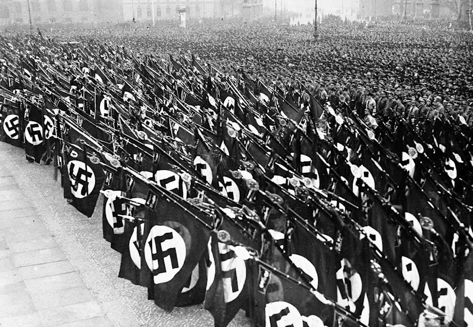 Tens of thousands of Nazi storm troopers take the oath of allegiance to Chancellor Adolf Hitler, in the Lustgarten, Berlin, Feb. 26, 1934. Nazi banners are dipped during the swearing of the oath.
