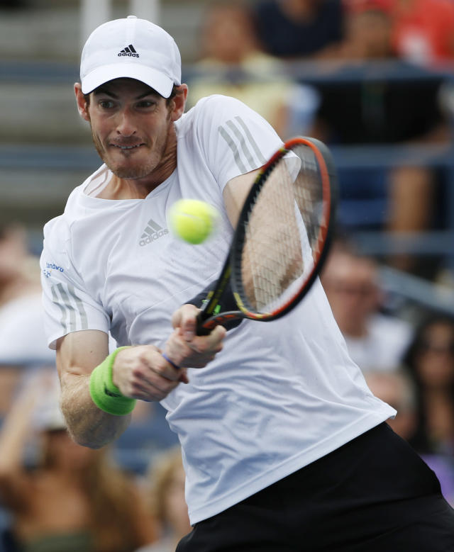 Andy Murray, of the United Kingdom, returns a shot against Andrey Kuznetsov, of Russia, during the third round of the 2014 U.S. Open tennis tournament, Saturday, Aug. 30, 2014, in New York. (AP Photo/Kathy Willens)