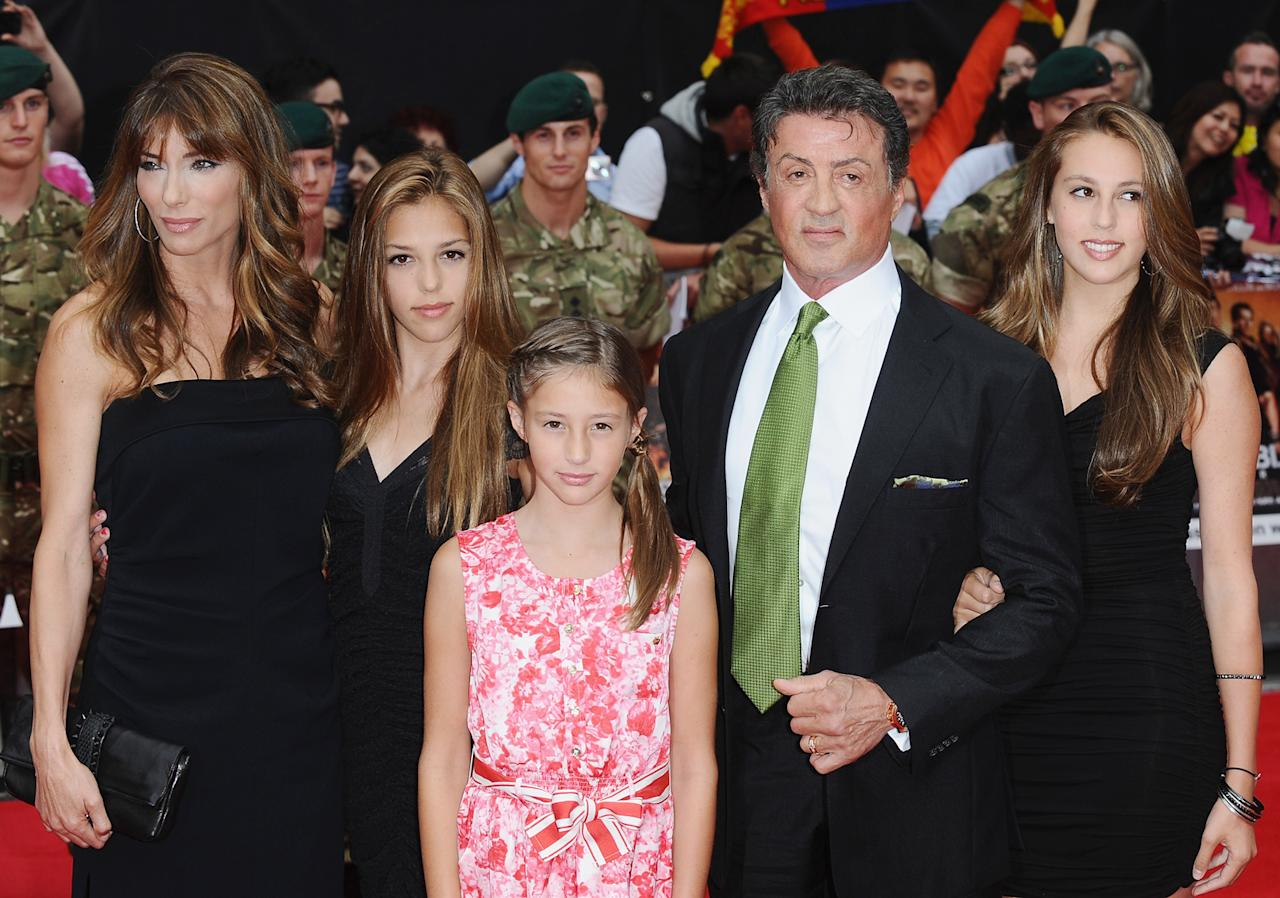 <p>Sistine and Sophia twinned it up at the UK film premiere of <em>The Expendables 2</em>, while all eyes were on Scarlet and her festive red-and-white printed dress (that and Sylvester's green tie). </p>