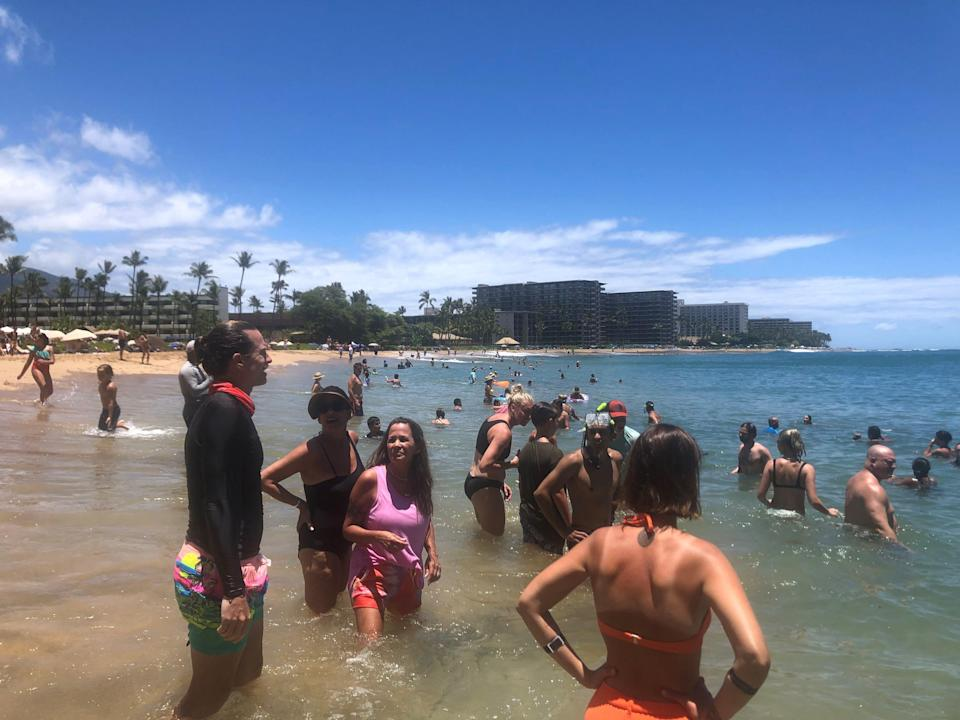 Kaanapali Beach, a popular tourist spot on the Hawaiian island of Maui, was busy on July 5. Maui tourism, which essentially shut down for seven months during the coronavirus pandemic, is approaching pre-pandemic tourism levels by some measures.
