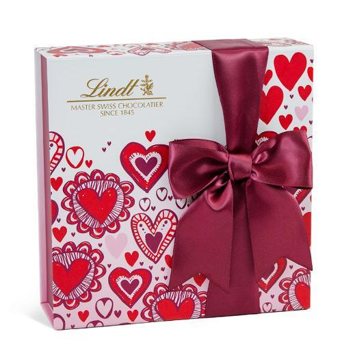"""<p>Chocolates for Valentine's Day are a classic, but this box puts a 2021 spin on the gift: You can completely customize the 40-piece box with her favorite flavors on Lindt's website.</p> <p><strong>Buy It! </strong>Share the Love gift box, $19.99; <a href=""""https://www.lindtusa.com/lindor-custom-mix--sc4/create-your-own-share-the-love-gift-box-%2840-pc%29-v006948sksk"""" rel=""""nofollow noopener"""" target=""""_blank"""" data-ylk=""""slk:lindtusa.com"""" class=""""link rapid-noclick-resp"""">lindtusa.com</a></p>"""