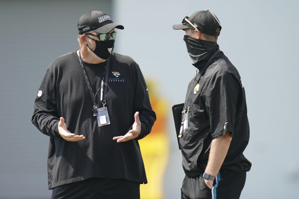 Jacksonville Jaguars head coach Doug Marrone, left, talks with Tad Dickman, director of public relations, during an NFL football workout, Wednesday, Aug. 12, 2020, in Jacksonville, Fla. (AP Photo/John Raoux)