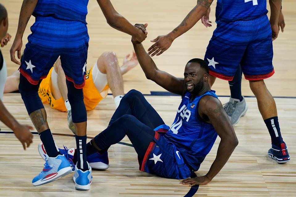 United States' Draymond Green is helped off the ground during an exhibition basketball game against Australia on July 12, 2021, in Las Vegas.