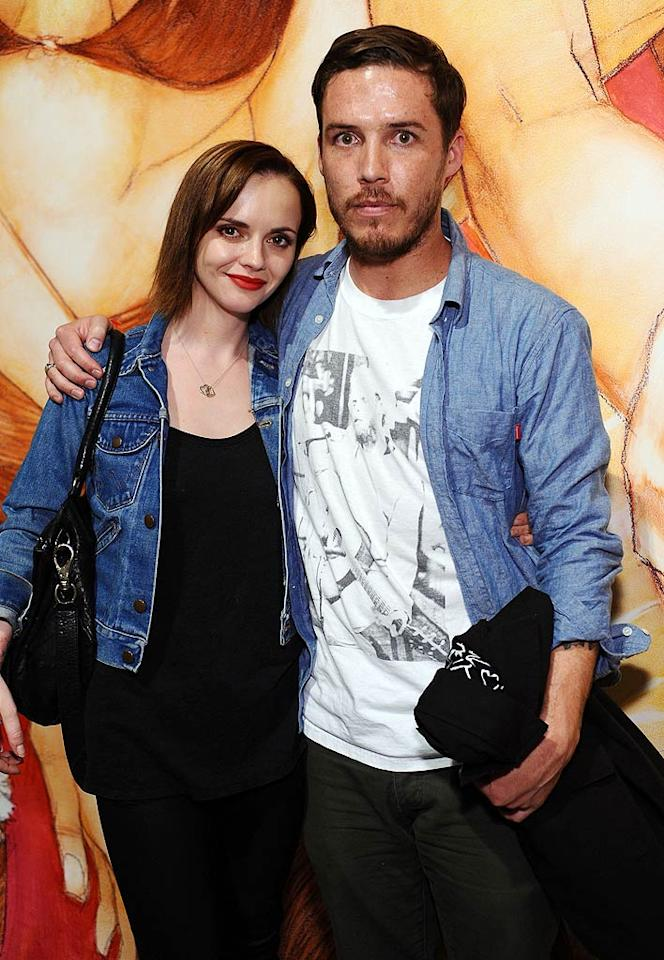 "Christina Ricci and boyfriend Curtis Buchanan got cozy in front of a piece of art. Stefanie Keenan/<a href=""http://www.wireimage.com"" target=""new"">WireImage.com</a> - April 1, 2011"