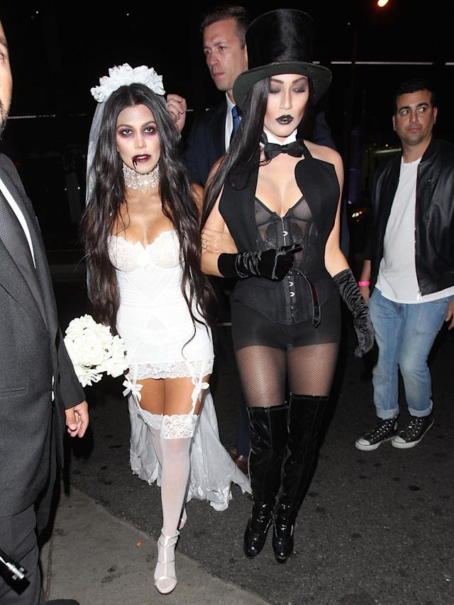 <p>Kylie's big sister Kourtney and a gal pal dressed as a sexy zombie bride and groom for a Halloween party held at Bootsy Bellows in West Hollywood. (Photo: Bello/Splash News) </p>
