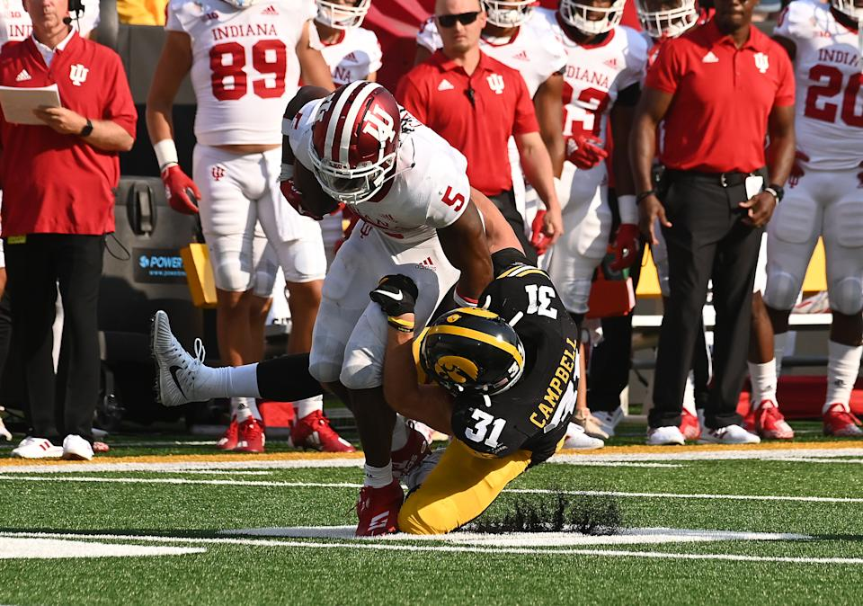 IOWA CITY, IA - SEPTEMBER 04: Iowa MIKE Jack Campbell (31) tackles Indiana running back Stephan Carr (5) during a college football game between the Indiana Hoosiers and the Iowa Hawkeyes on September 04, 2021, at Kinnick Stadium, Iowa City, IA. (Photo by Keith Gillett/Icon Sportswire via Getty Images),