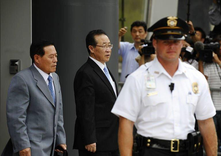 """North Korean Vice Foreign Minister Kim Kye-Gwan (C) departs the US Mission to the United Nations after meetings with Ambassador Stephen Bosworth, the Obama administration's top envoy on North Korean affairs. The United States on Thursday pressed North Korea to take """"concrete and irreversible"""" steps to give up its nuclear arsenal at talks on how to improve hostile relations"""