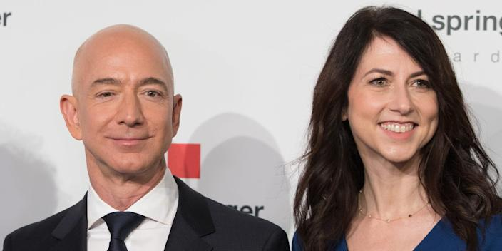"Amazon CEO Jeff Bezos and his now ex-wife MacKenzie Bezos poses as they arrive at the headquarters of publisher Axel-Springer where he will receive the Axel Springer Award 2018 on April 24, 2018 in Berlin. <p class=""copyright"">ORG CARSTENSEN/dpa/AFP via Getty Images</p>"